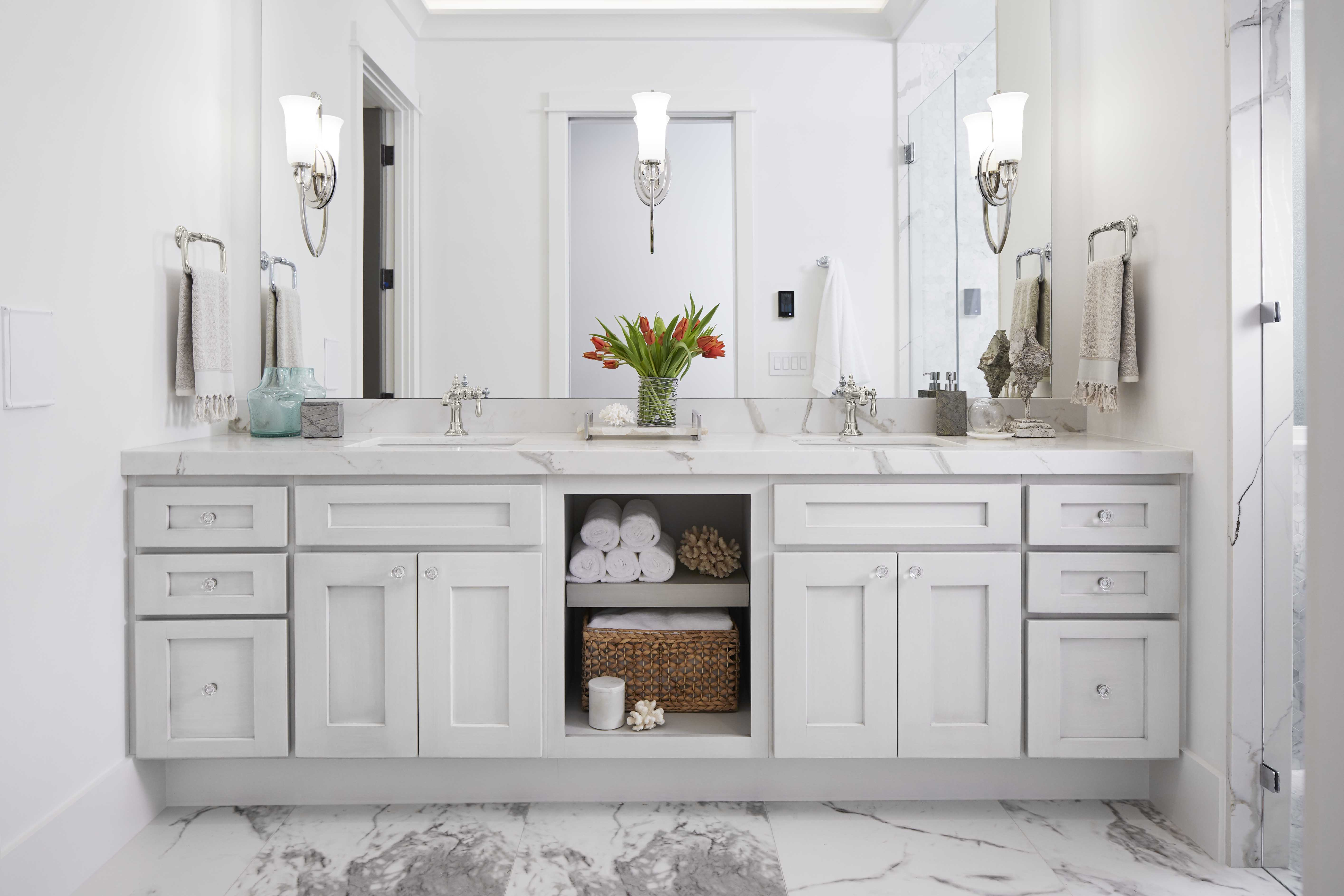 Verticyl Undermount Sink     Artifacts Bathroom Sink Faucet     Dual styling spaces in the master bathroom bring streamlined efficiency to morning routines. Traditional materials in a classic gray and white palette help create a timeless look.