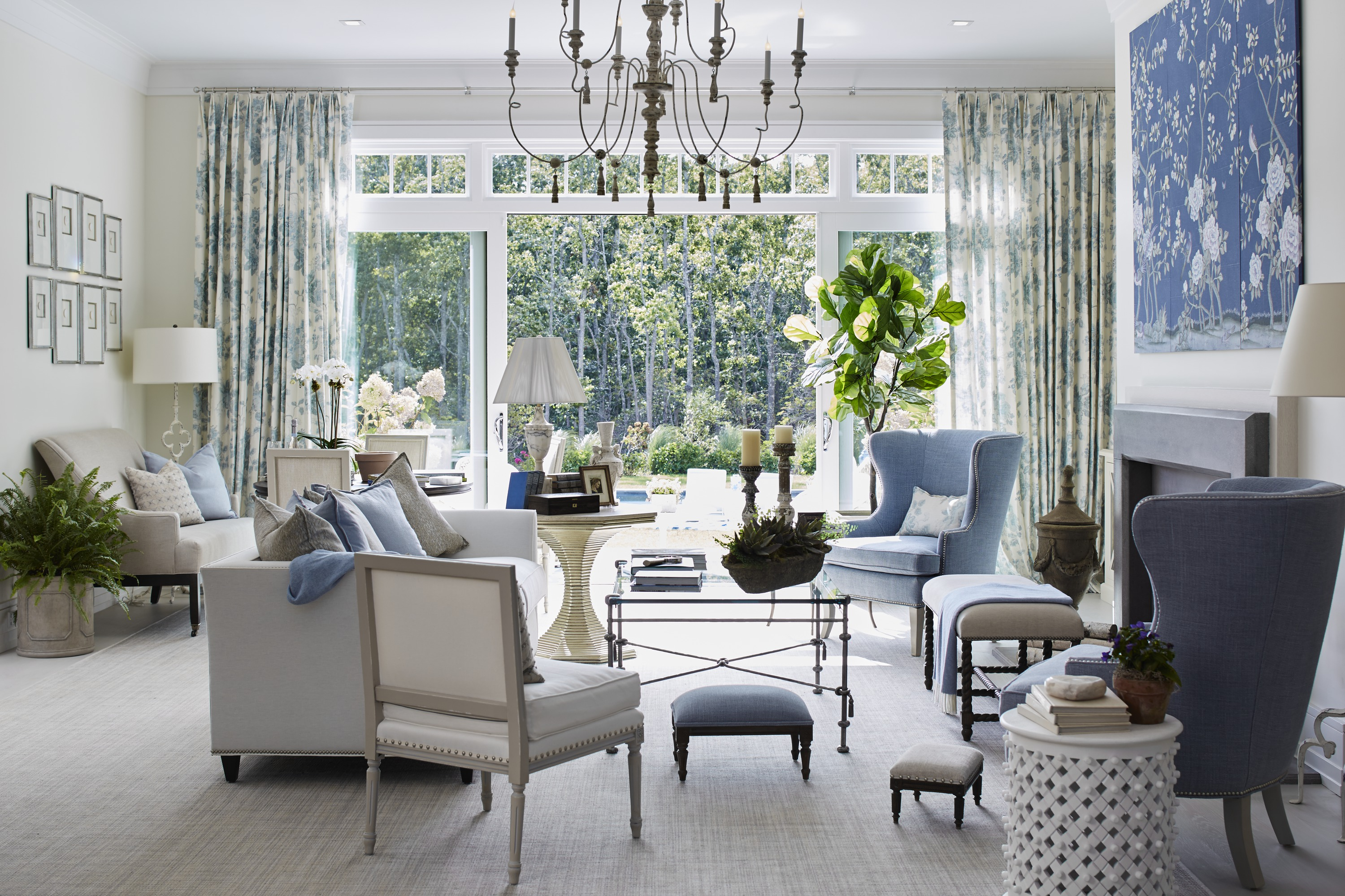 Designed by Kate Singer, this summer-hued great room draws its color palette and patterns from outdoors. Its essence is beautifully captured in the hand-painted de Gournay mural above the fireplace.