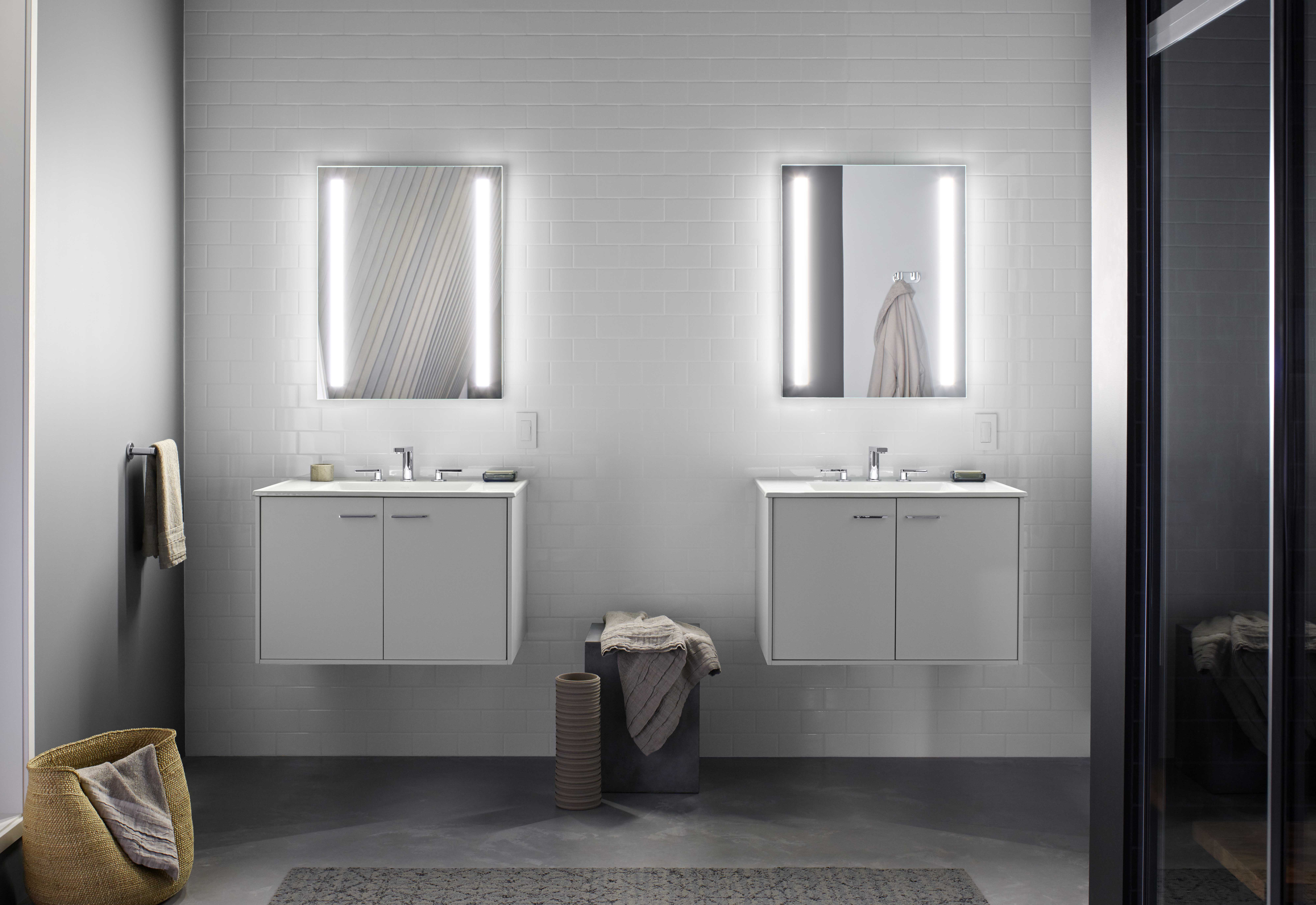 Jute® Vanity     Verdera lighted medicine cabinet     Composed Faucet     Wall-hung vanities enhance the room's contemporary design and spaciousness.