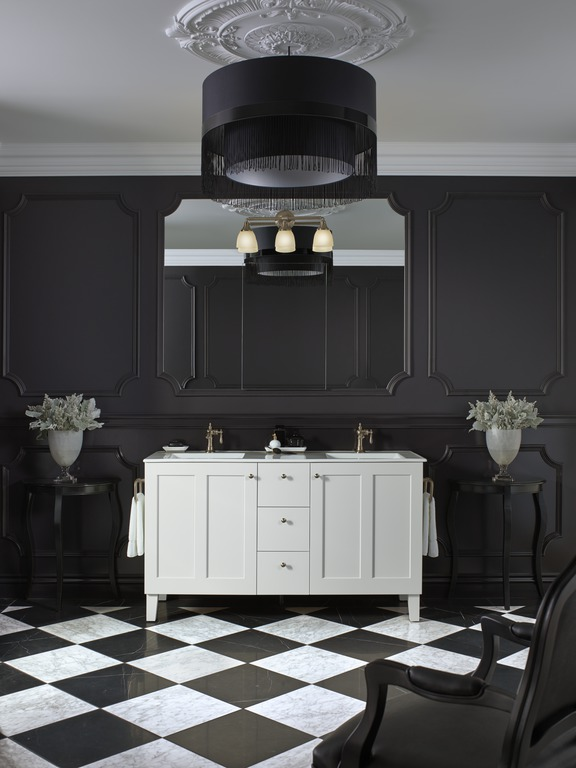 Devonshire wall sconce   Artifacts faucet   Poplin vanity   Classic details combine with black for a striking update on traditional style.