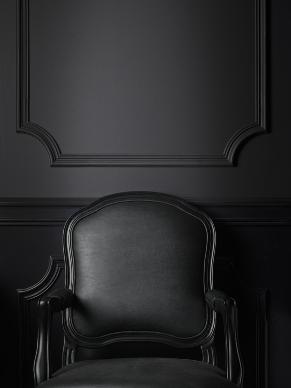 Mixing matte and glossy paint sheens adds intrigue to black walls.