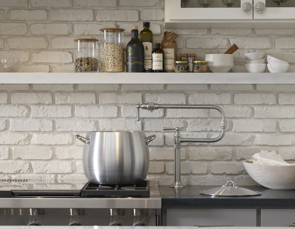 HiRise Pot Filler     A gas range pairs perfectly with a convenient pot filler to add even more character and functionality to the holistic design of this kitchen.