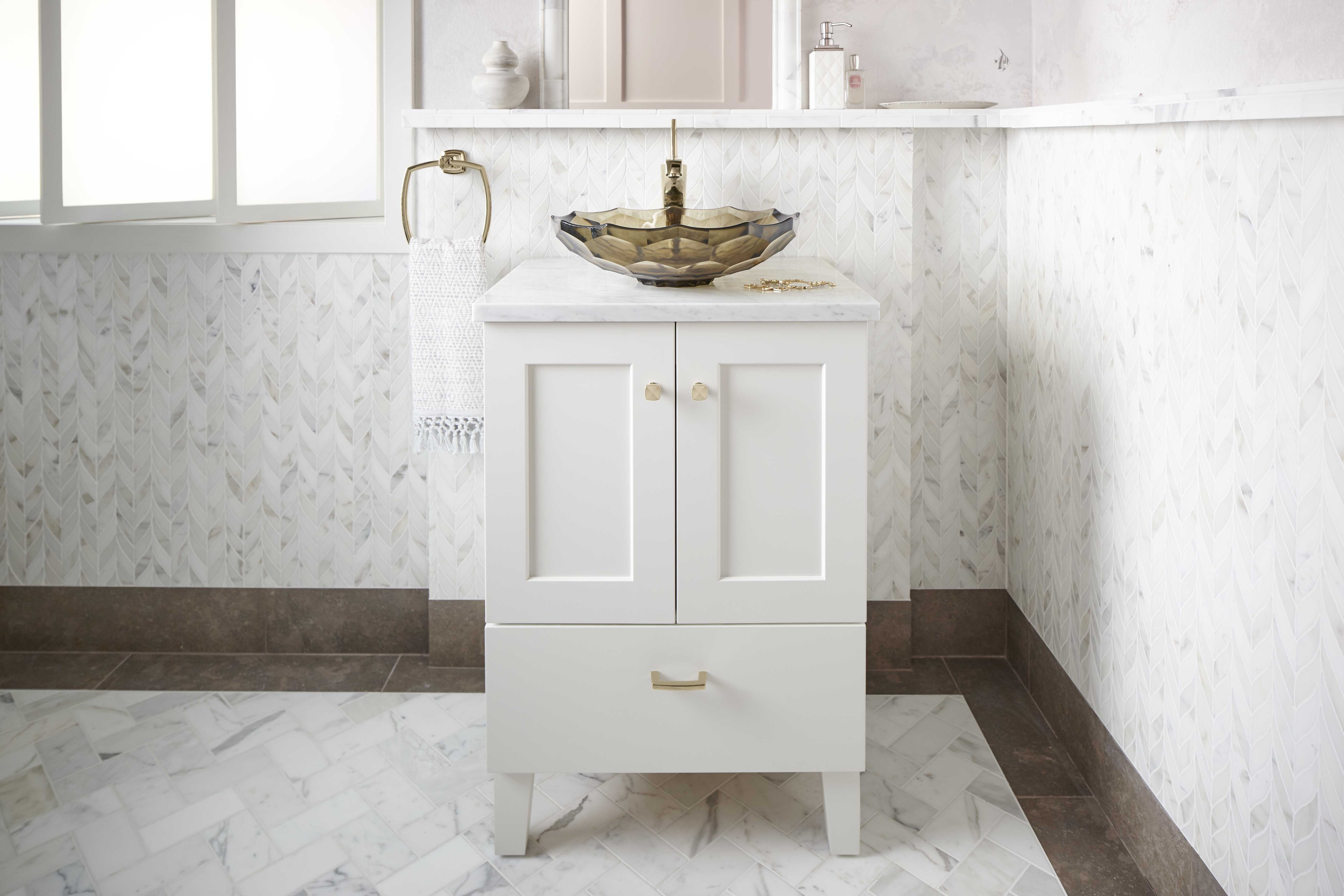 Poplin® Vanity     Margaux® single-handle faucet     Briolette™ Vessel Sink     Intricate wall and tile patterns create a striking juxtaposition for this simple white vanity.