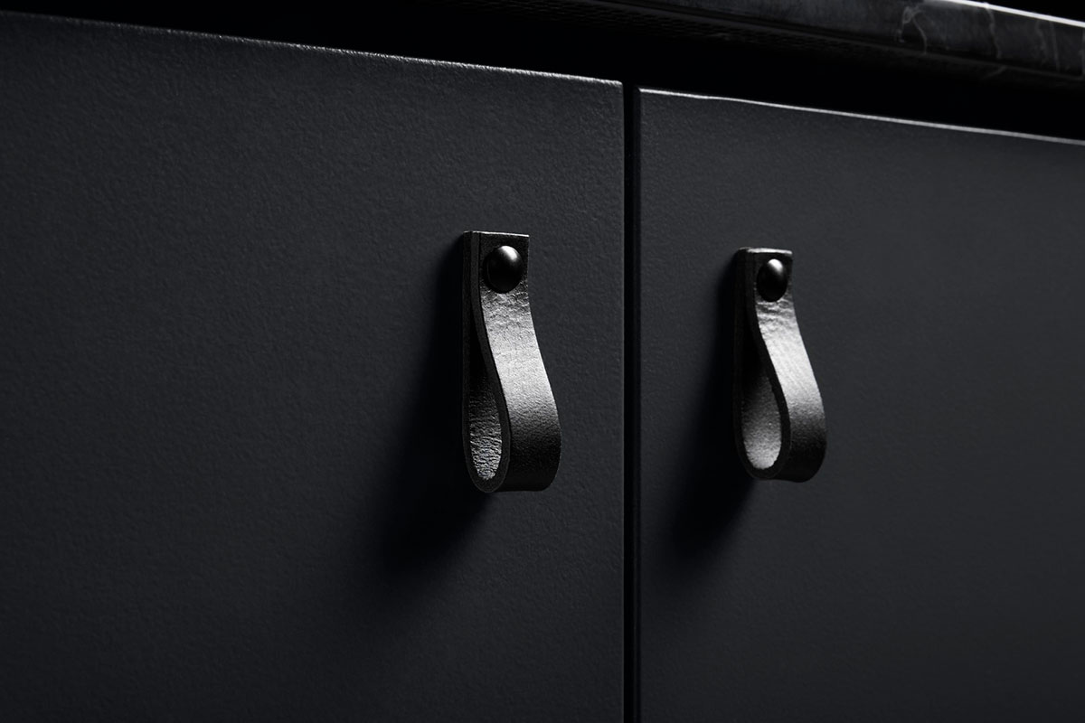 Bring a soft, organic element into a linear modern space with leather cabinet pulls.