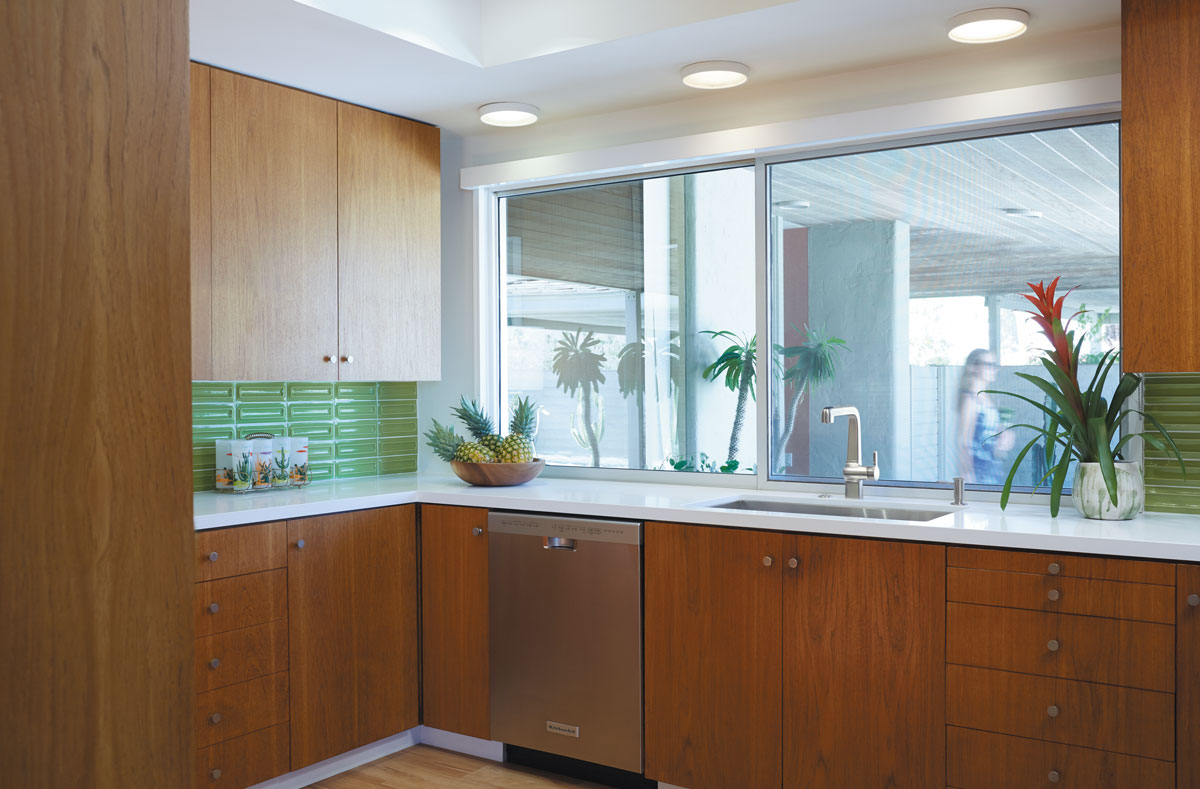 Evoke Faucet    Strive Sink    Soap/Lotion Dispenser    Updating the kitchen with glass tile backsplashes and new sinks and faucets gives the space smart functionality while maintaining the mid-century modern aesthetic.