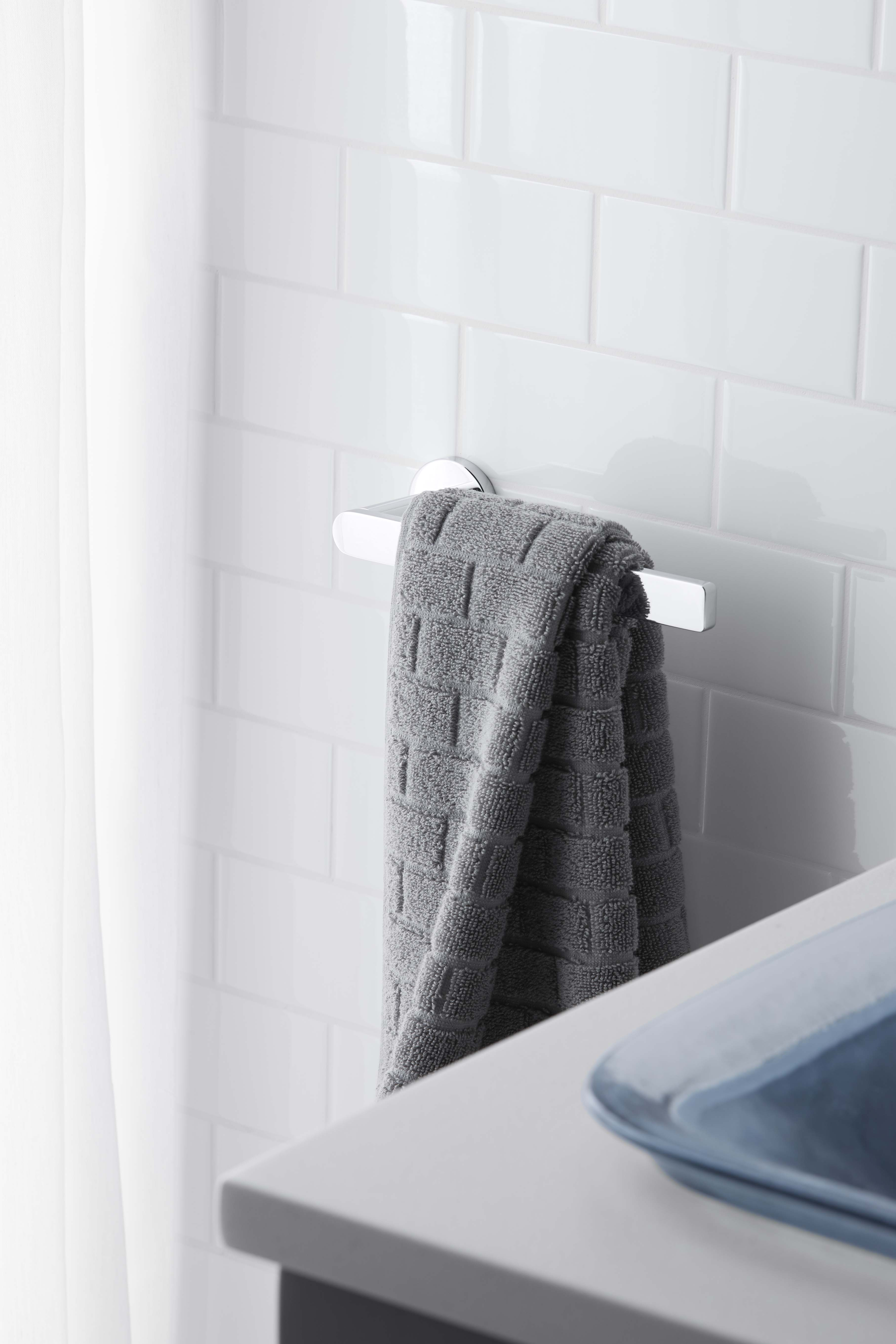 Composed Towel Arm     A sleek towel arm matches the timeless simplicity of the sink and bath faucets.