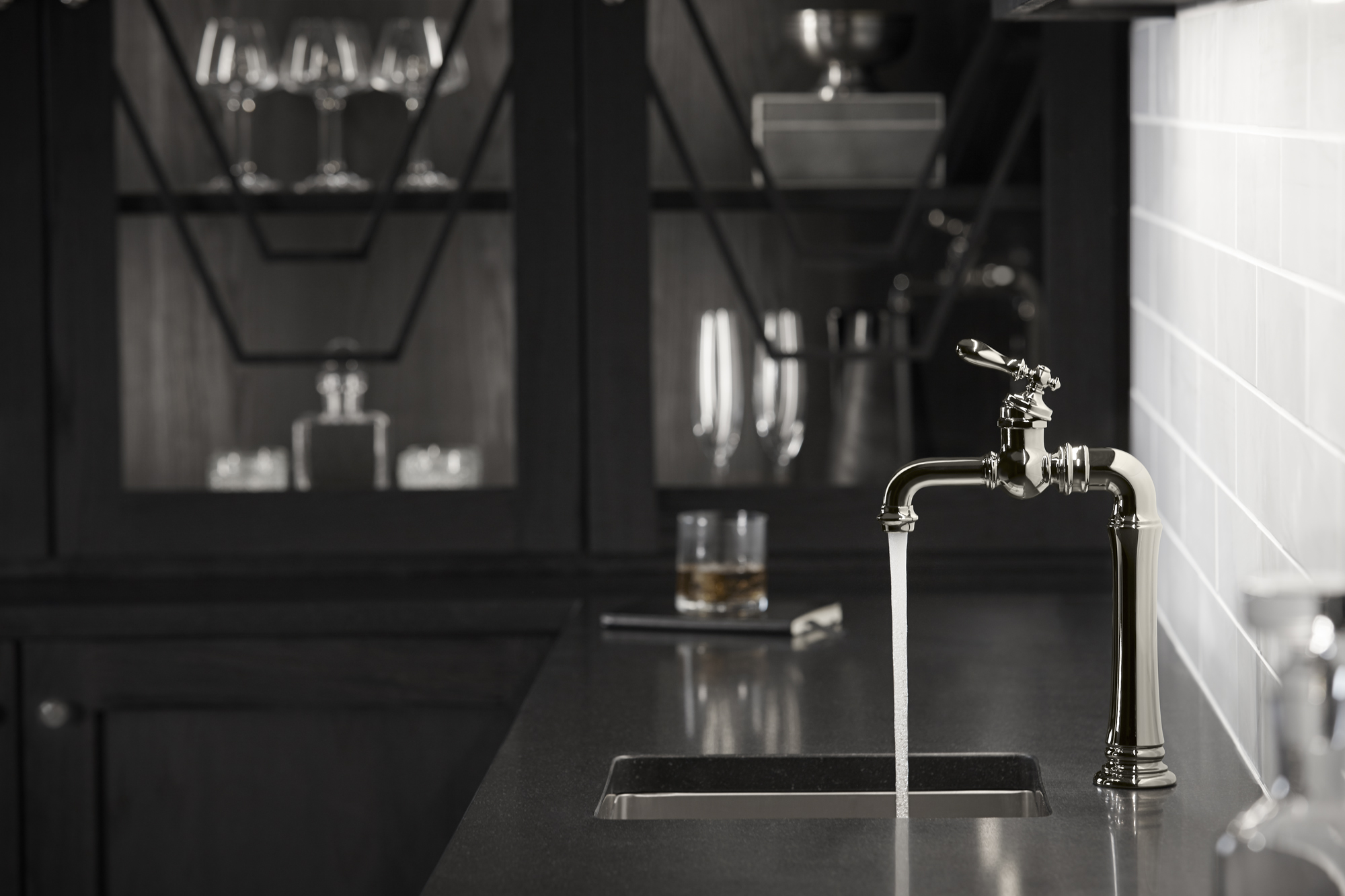 Artifacts Gentleman's bar faucet     Strive bar sink      Featuring a signature top-mount lever handle, the bar faucet evokes the comfort and camaraderie of a favorite pub.