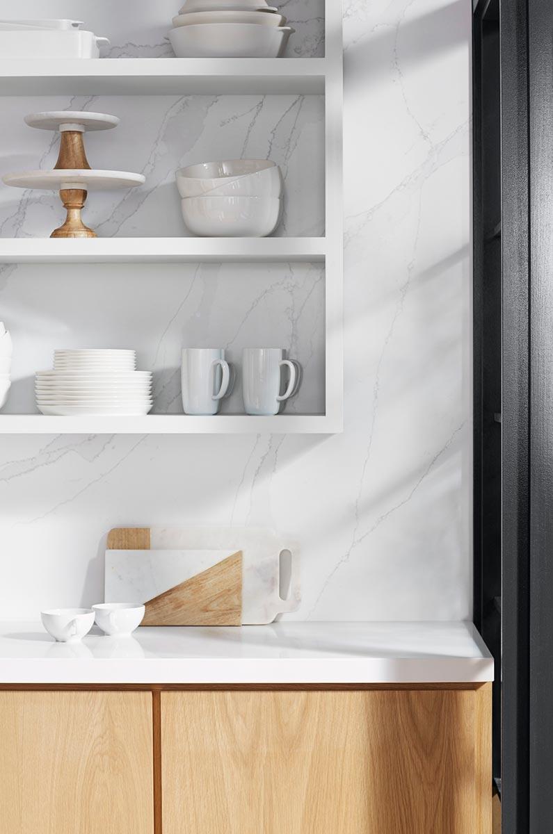 Silestone Eternal Calacatta Gold Backwall     Silestone Iconic White Countertop      When decorating with open shelves, use color coordinated accessories and tableware with subtle color accents to animate the design.