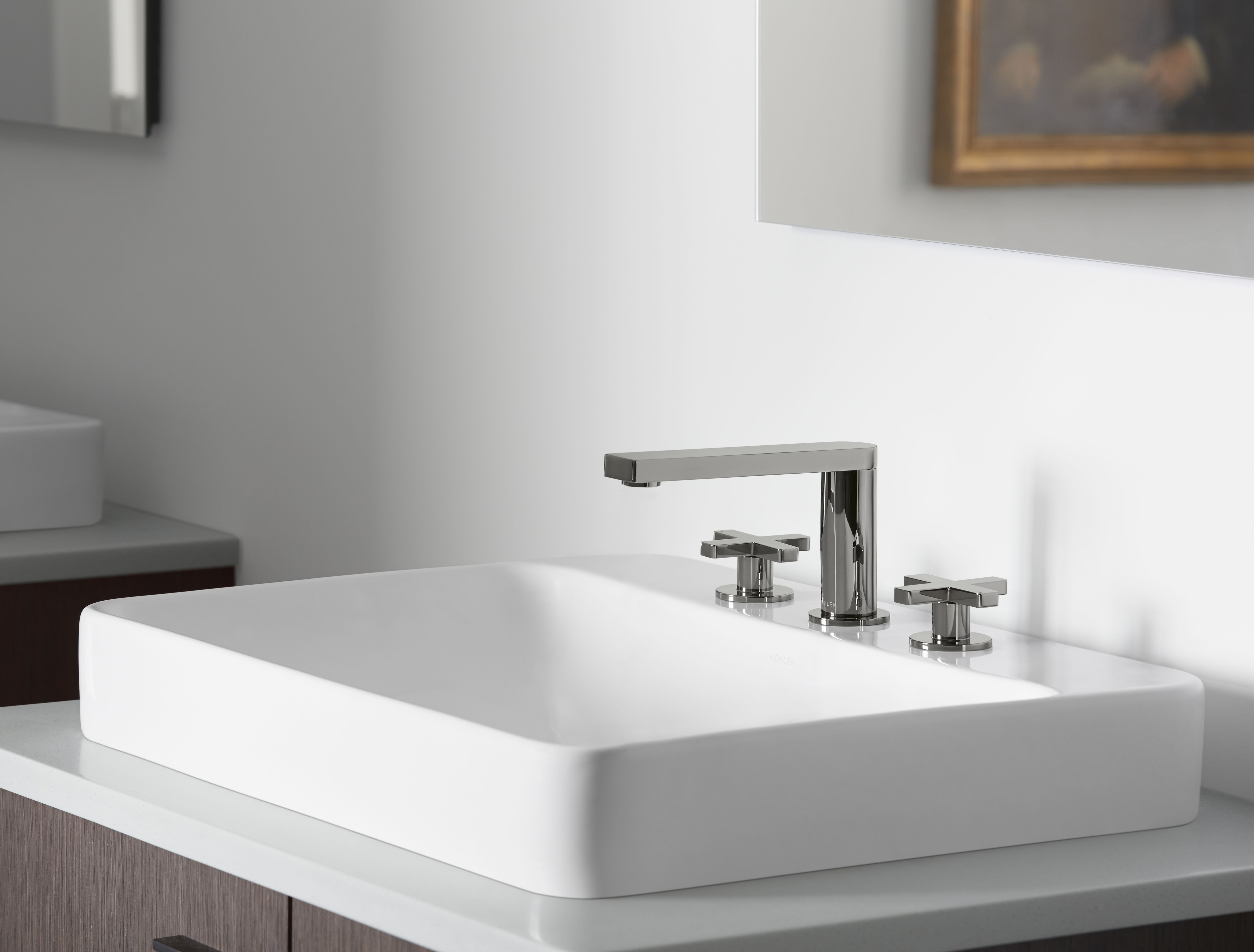 Composed Faucet     Vox Sink     The edgy, cool metallic of this Vibrant® Titanium finish elevates the faucet's clean, streamlined design.