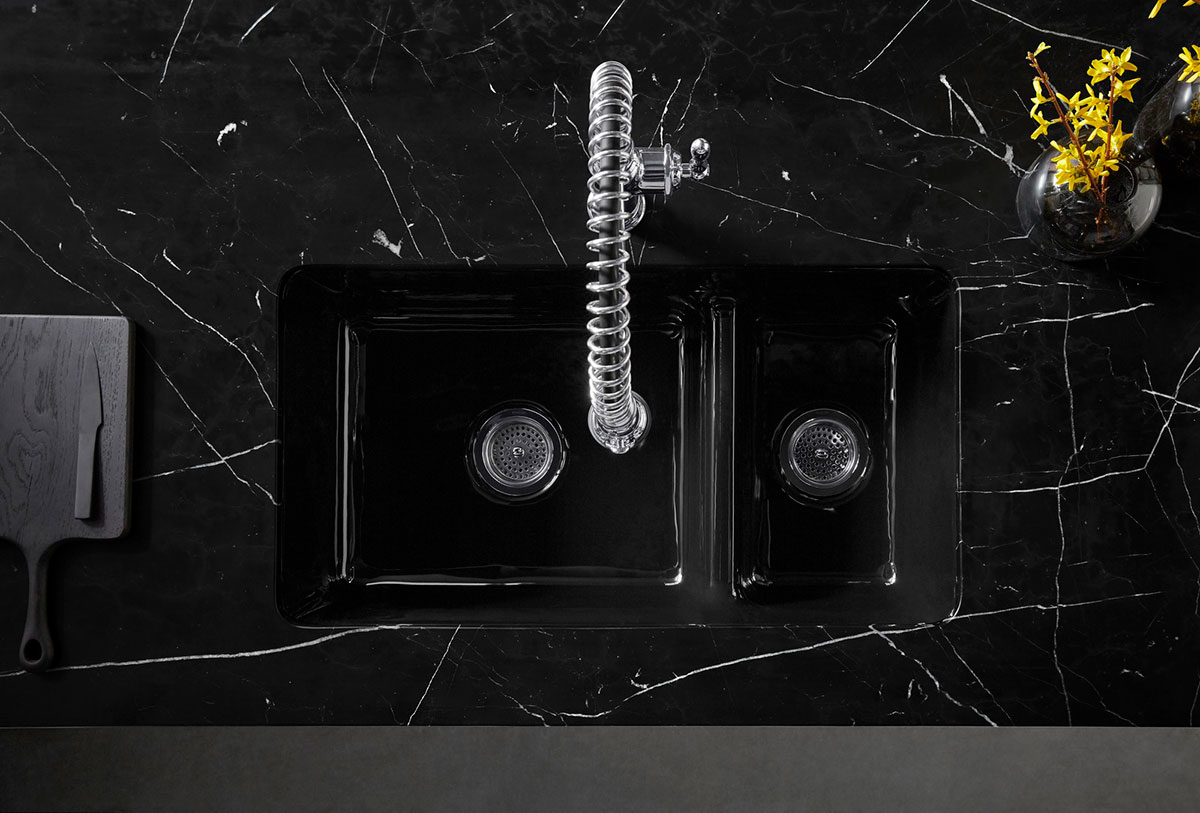Tournant Faucet    Iron/Tones Sink    ANN SACKS Nero Marquina Slab   Art and functional design flow together with a minimalist sink that morphs into an island of shadowy Nero Marquina marble.