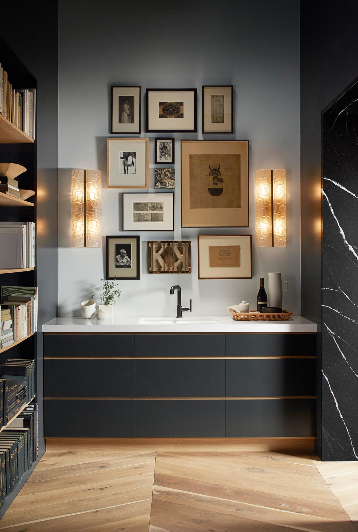 Riverby Bar Sink     Purist Faucet      When designing your space, create tension and interest with irregularity. Here, an asymmetrical collage of wall art balances the linear style of the countertop and bar.