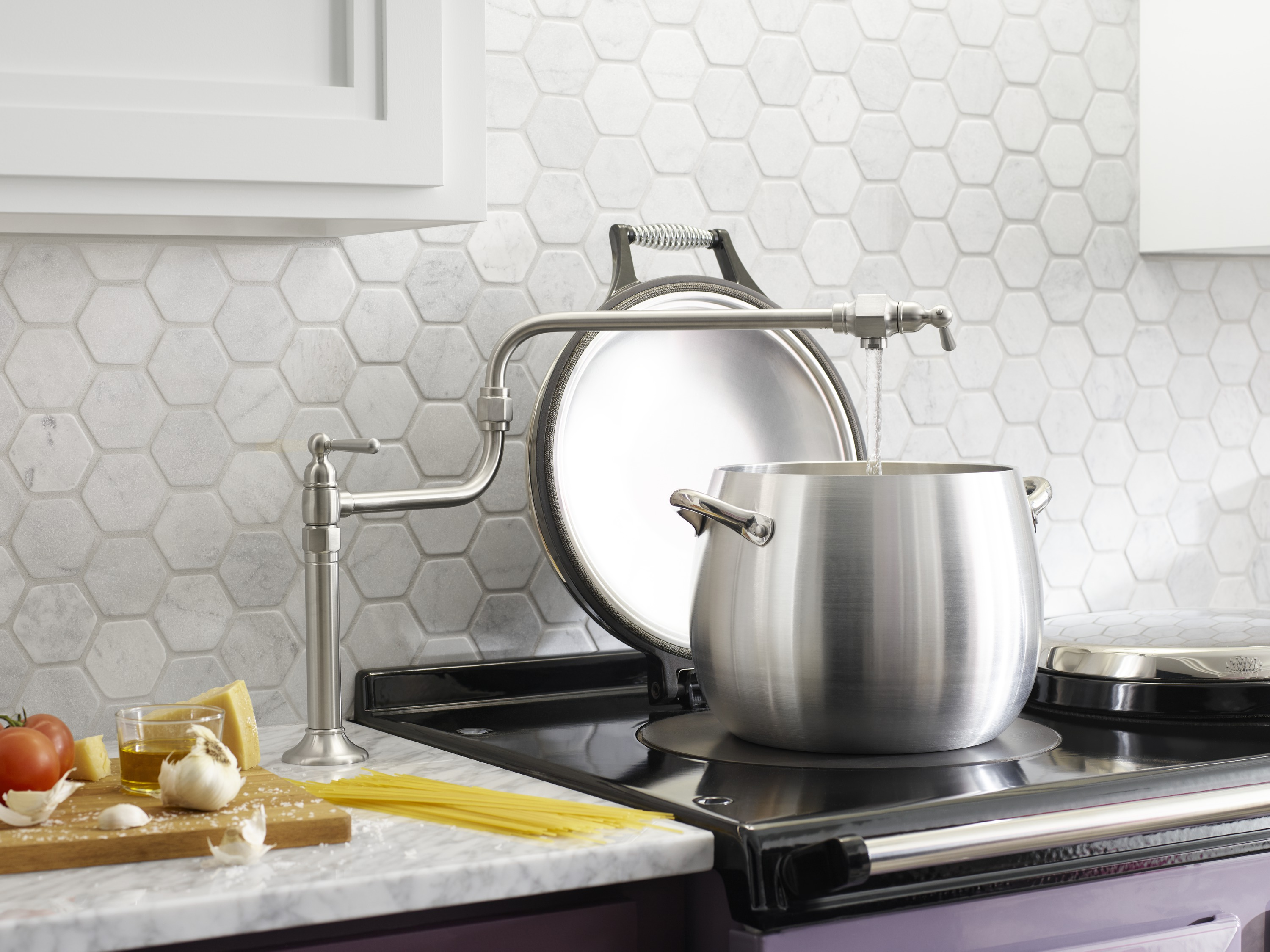 HiRise™ pot filler     A pot filler mounted on the counter can be used to easily fill pots, coffee makers, vases and more.