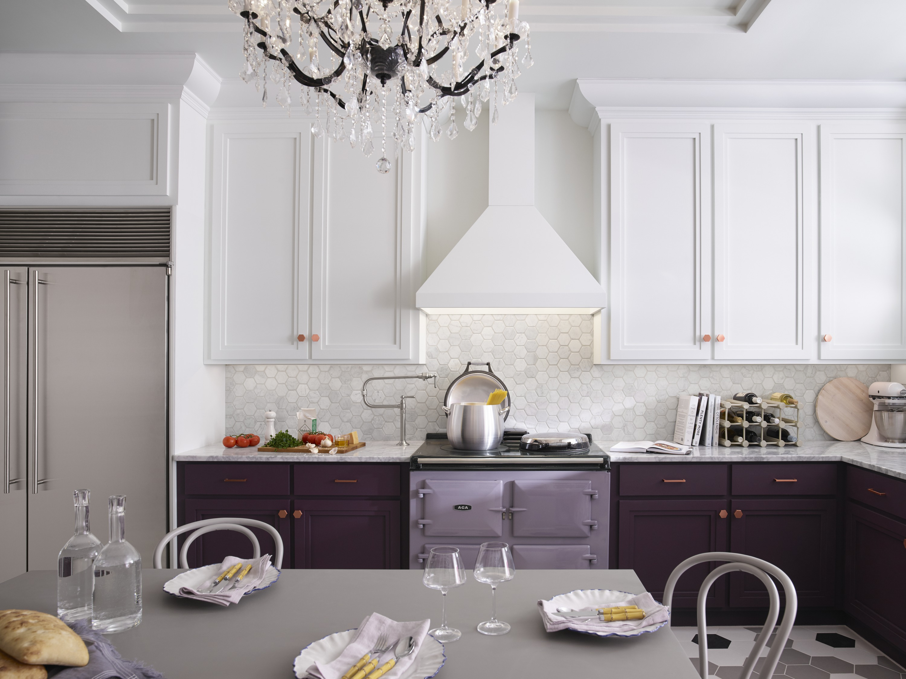 HiRise™ pot filler     Solid colors on the wall, range hood and cabinets balance the patterns of the wall and floor tiles.