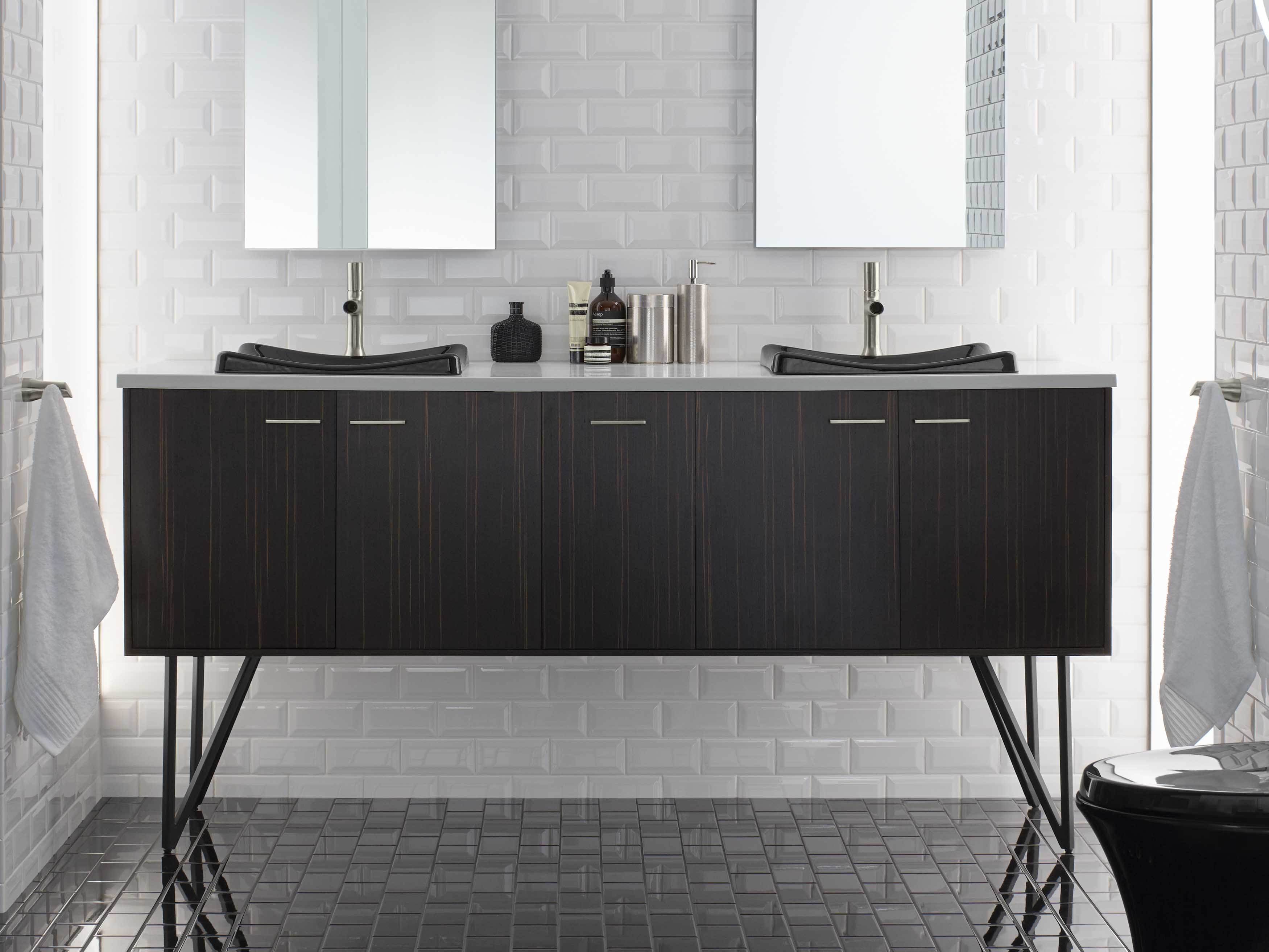 Jute® Vanity     Margaux® Faucet     Vertical patterns in the wood vanity and wall tile combine with the stretched octagonal mirror to make the space feel taller.