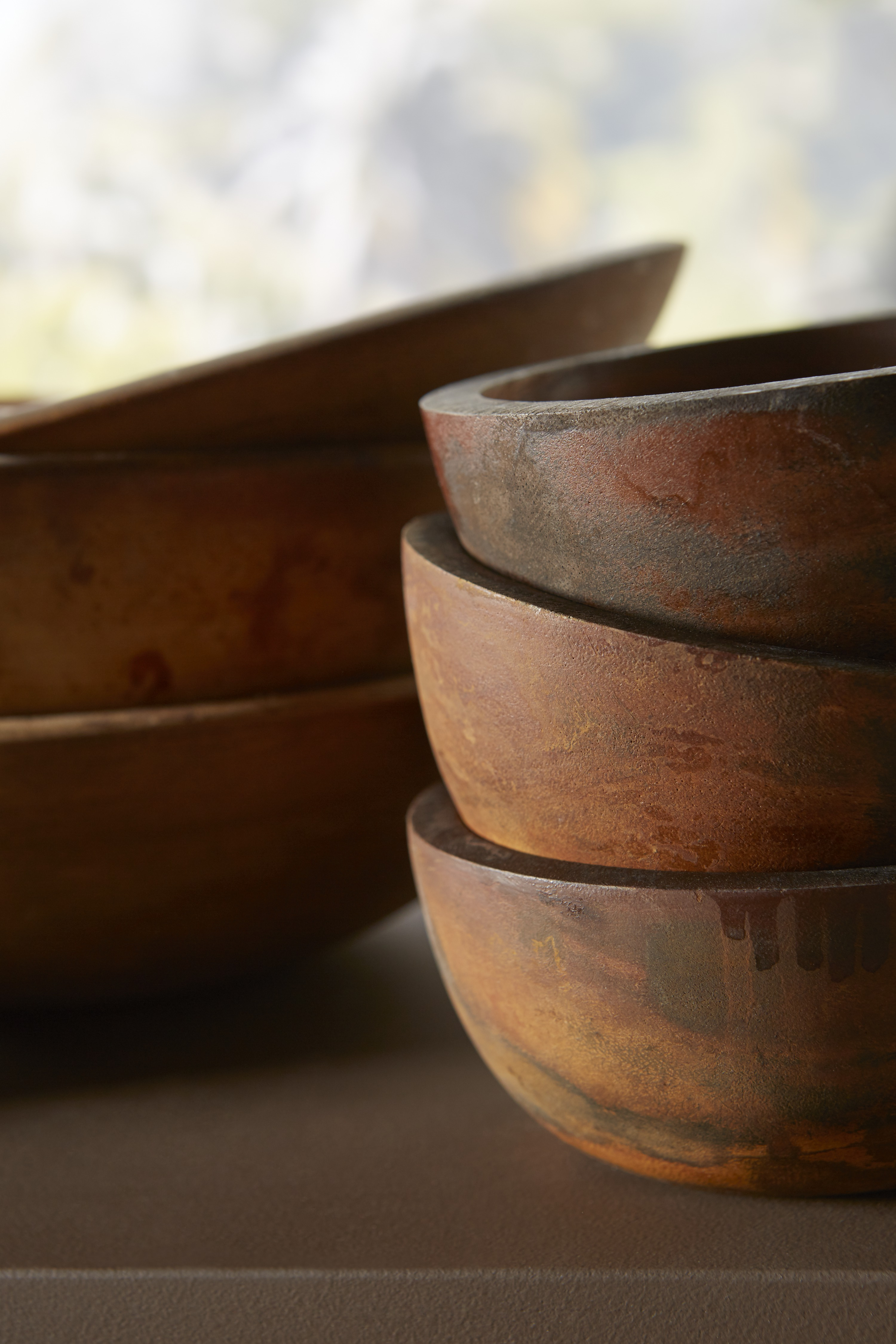 With rich colors, these wood bowls reinforce design elements used throughout the kitchen.