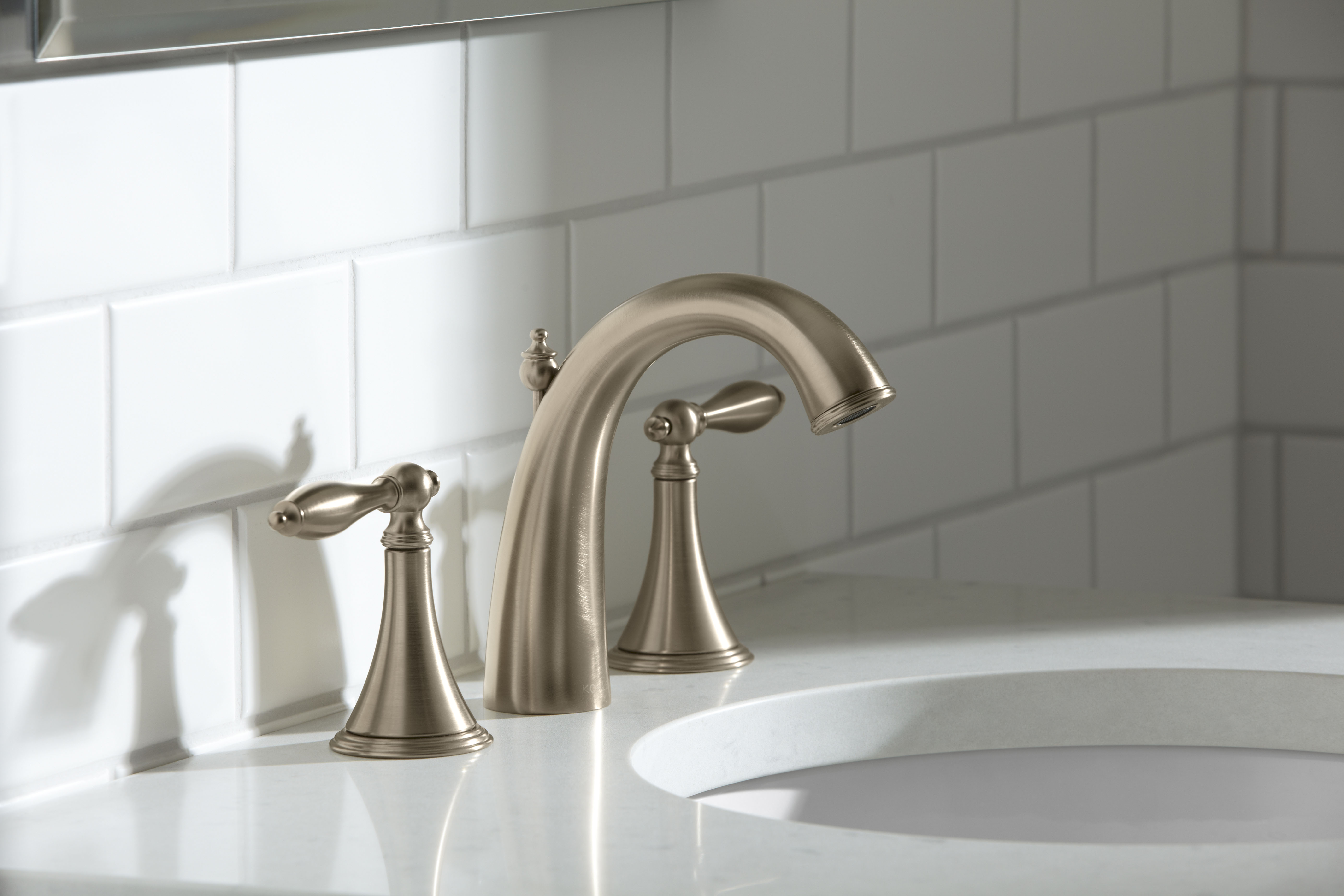 Verticyl Sink     Finial Traditional Faucet     With its subtle tones, a Vibrant Brushed Bronze finish can soften the refined details of a traditional faucet and complement modern environments.