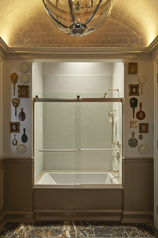 Margaux showerhead   Forte handshower   Margaux valve trim   Underscore bath  and  Margaux bath spout   A modern shower goes glamorous thanks to gold-finish faucets, a gold-leaf ceiling and lots of gleaming decorative touches.