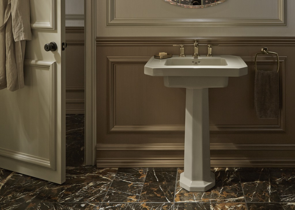 Margaux faucet   Kathryn pedestal sink   Dual-toned walls and plenty of architectural detail add richness to a classic space.