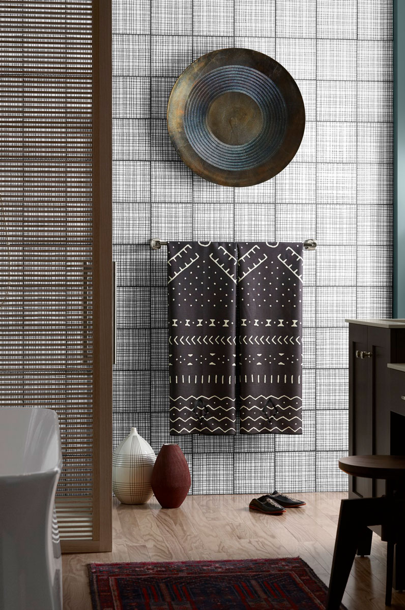ANN SACKS Maven Field Tile    Crosshatched tile walls and Shoji-style doors enclose the showering space in a colorful mashup of eastern influence and contemporary style.