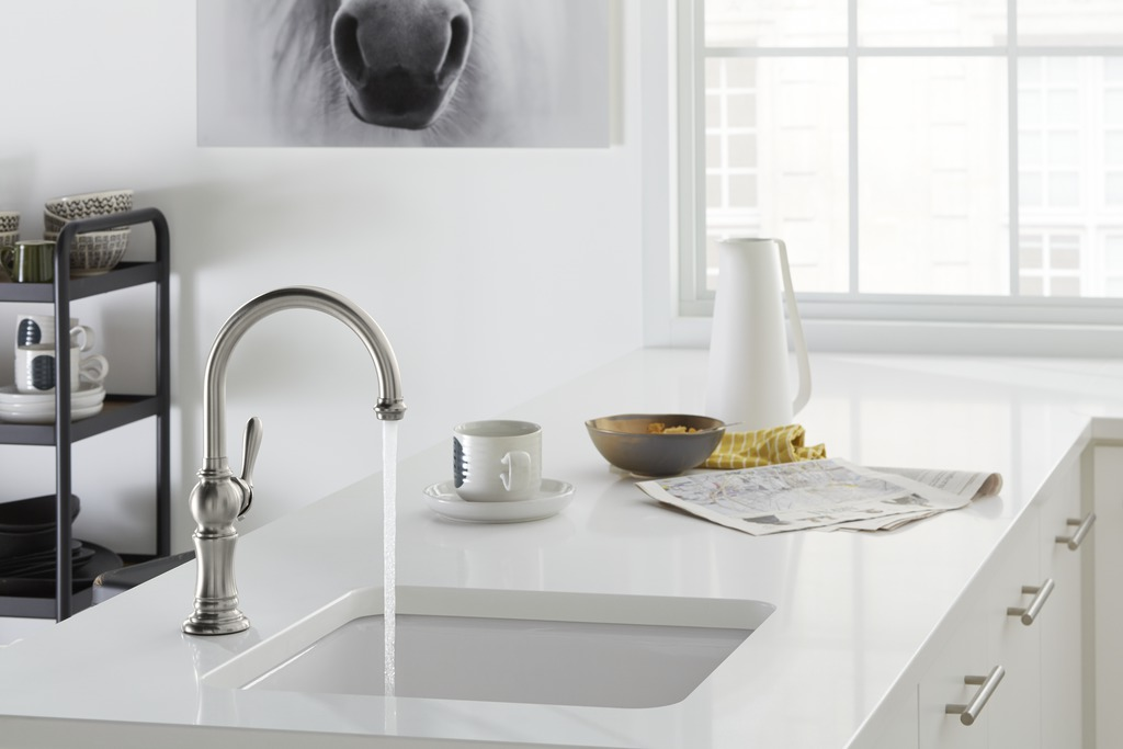 Artifacts single-hole faucet   Iron Tones bar sink   The undermount bar sink adds complementary function away from the busy primary sink. A stately faucet with high-arch swing spouts provides a classic counterpoint.