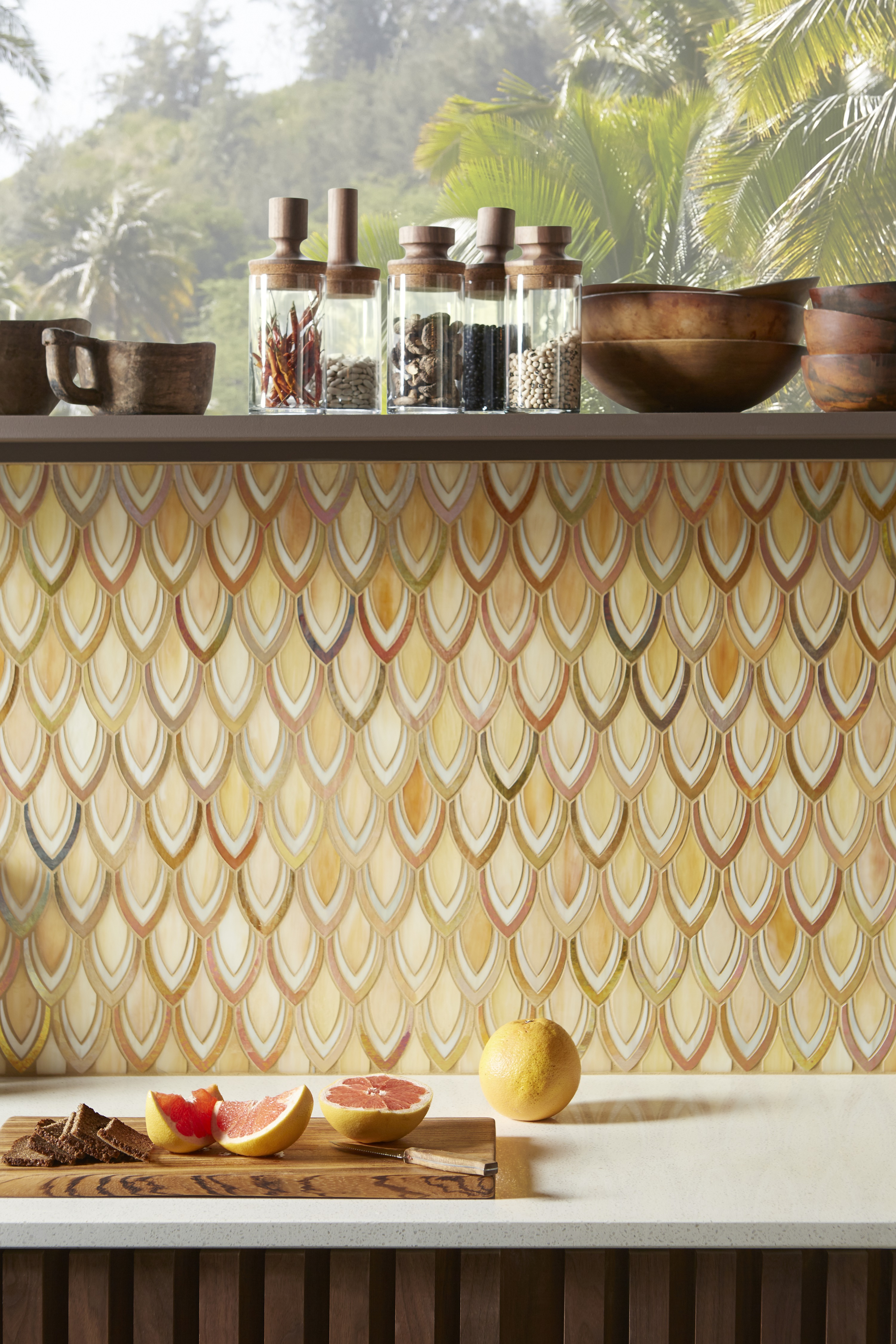 ANN SACKS® Chrysalis mosaics tile     Endlessly shifting from playful pinks and blues to sunny golds and browns, the iridescent backsplash with metallic veining brings movement and vitality to the design.