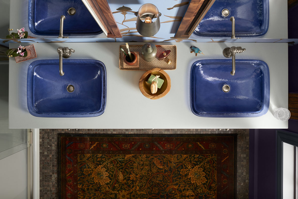 Inia Sink    Artifacts Faucet    Solid/Expressions Vanity Top    Verdera Medicine Cabinet    Damask Medicine Cabinet Surround    A vanity countertop pops with side-by-side sapphire-colored sinks that bring personality and purpose to the styling space.