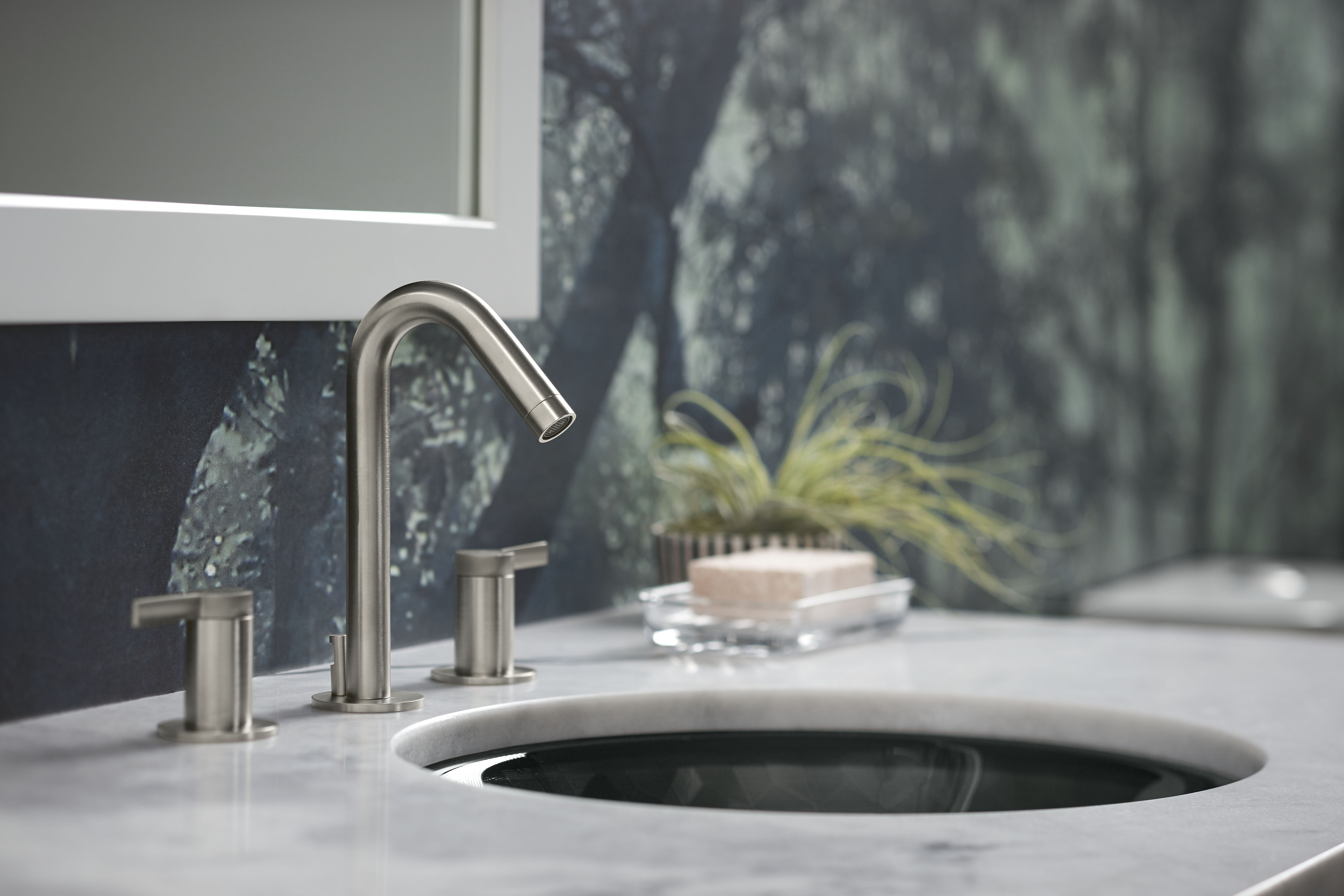 Stillness Faucet     Kallos Sink     The warm Vibrant Brushed Nickel finish on this minimal faucet enhances the space's simple, organic appearance.