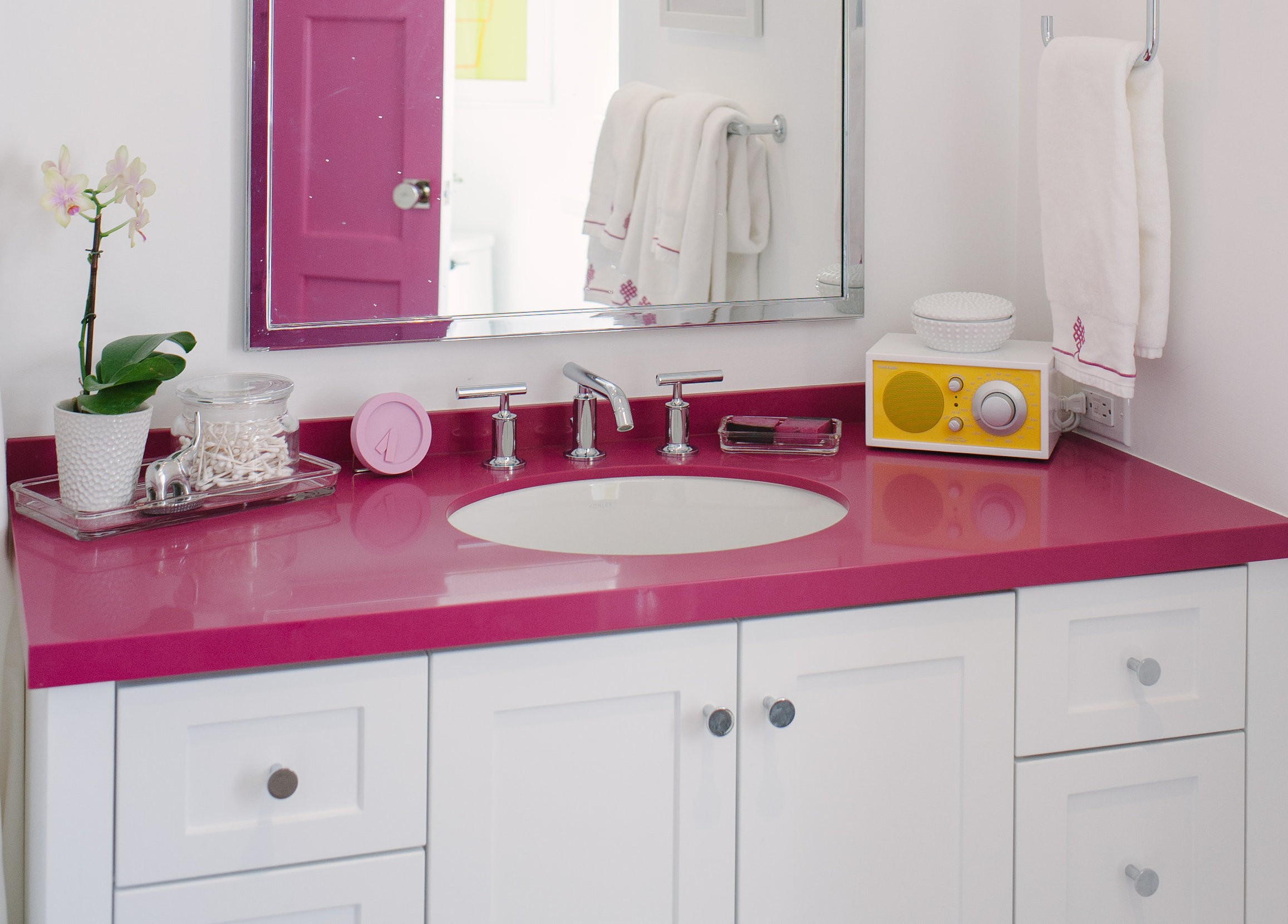 Purist faucet   Verticyl sink    Lewis chose simple, understated faucets and fixtures to complement the bright color in Harper's bathroom. She chose yellow as a third pop of color because of its cheerful, positive energy.