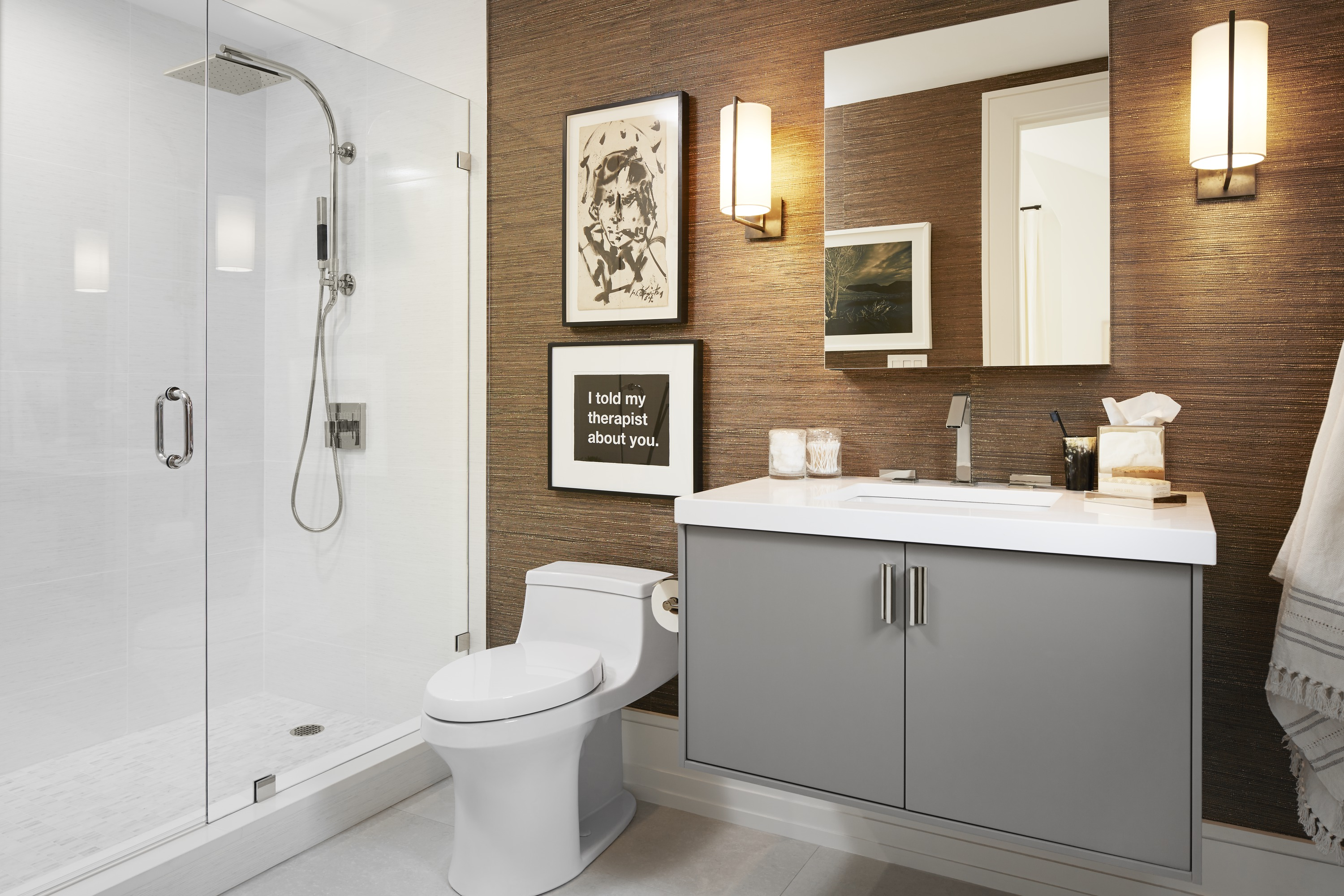 Loure Faucet     Jute Vanity     San Souci Toilet     HydroRail-R Shower Column     Contemporary Square Rainhead     Continuing the design vernacular of the bedroom, this en-suite bath features sleek silhouettes and natural grasscloth wallcovering for a grounded contemporary sensibility.