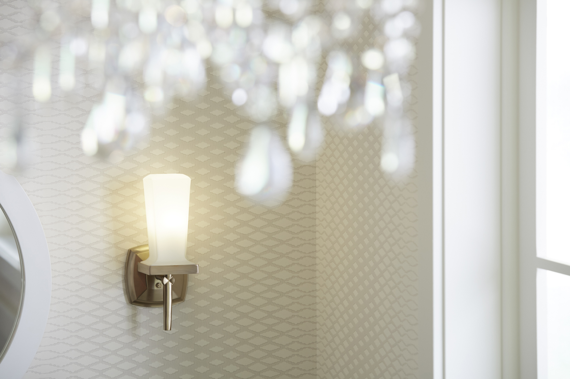 Margaux® sconce    Designed to match the faucet and accessories, this sconce balances formal elegance with a sleek silhouette.