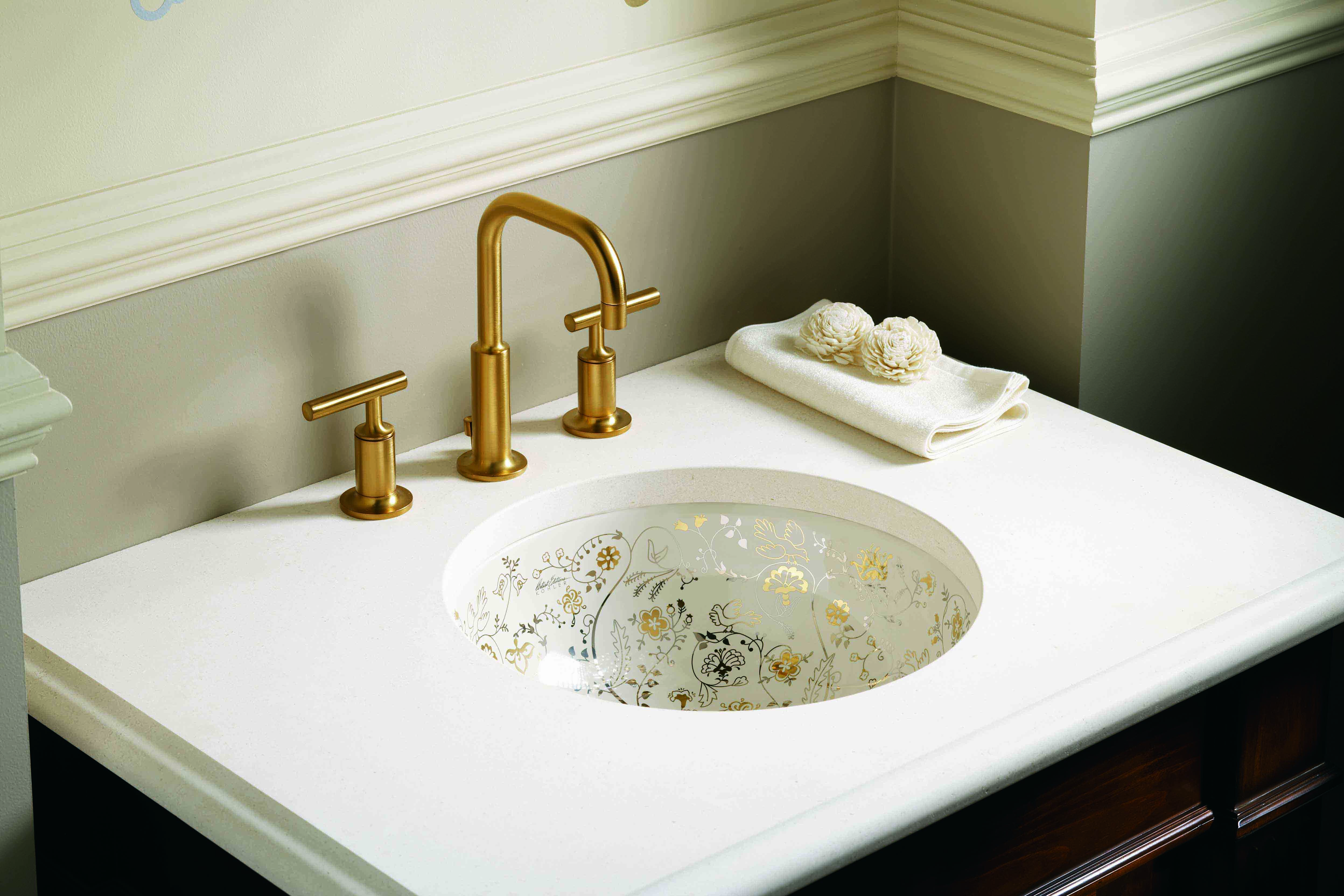 Purist Faucet     Mille Fleurs Sink     Juxtaposing an ornate sink with a simple Vibrant® Brushed Moderne Gold faucet makes a unique style statement.
