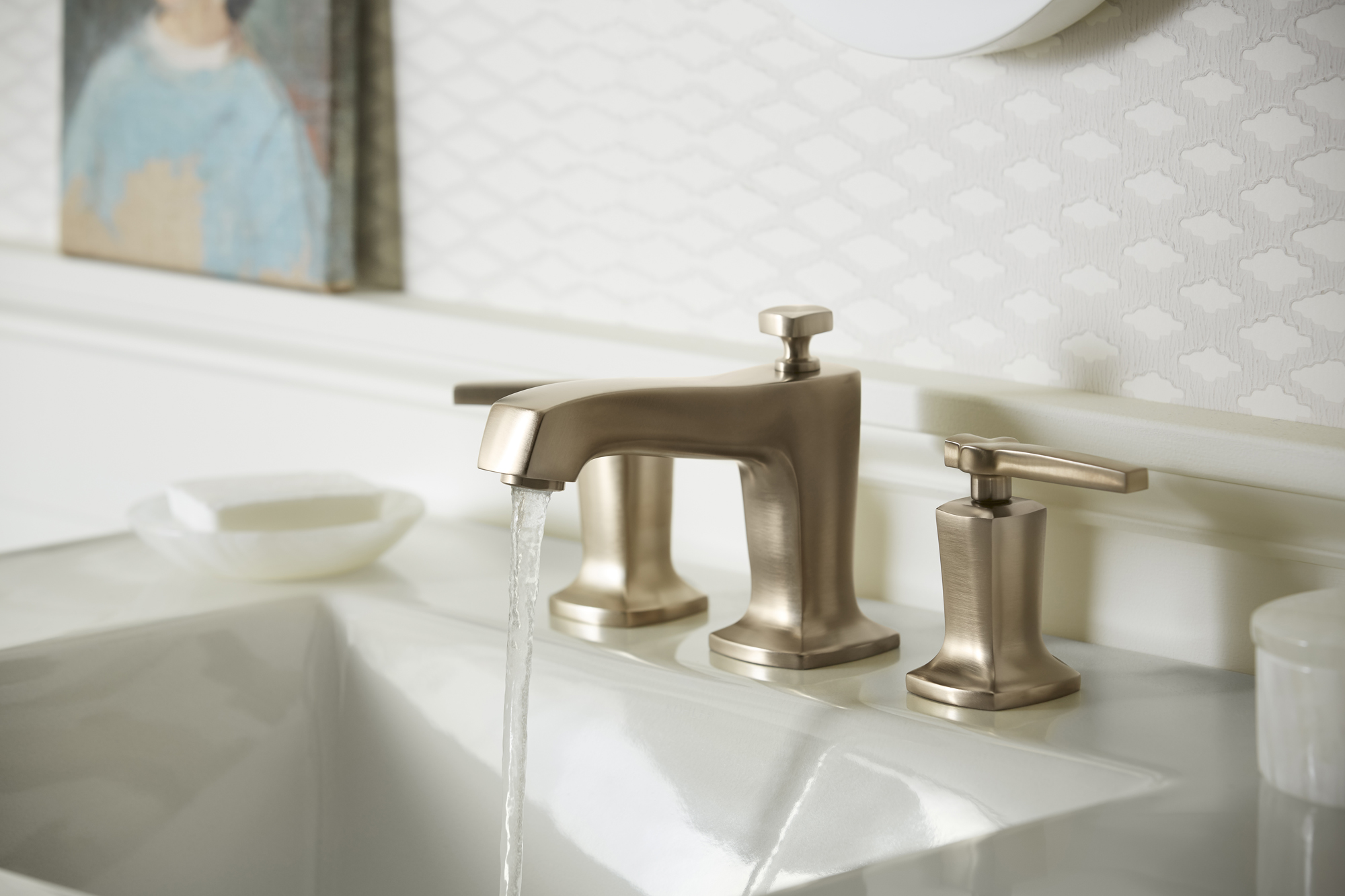 Ceramic/Impressions® sink     Margaux® faucet     With its subtle pillow-top detailing and Vibrant® Brushed Bronze finish, this faucet adds a delightful contrast to the room's muted palette.