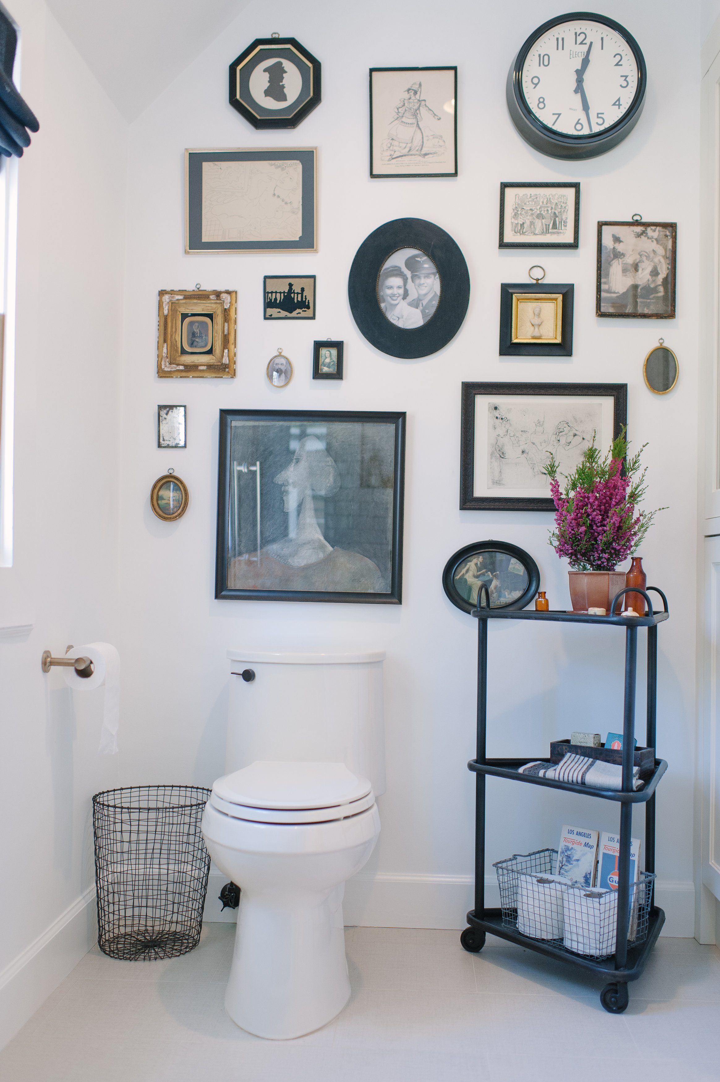 Adair toilet   Framed profiles and silhouettes include a few family photos to personalize the space.