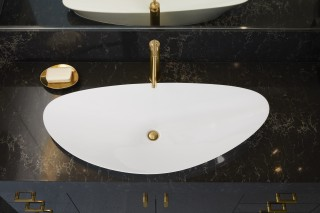 Veil™ trough vessel bathroom sink    Purist® bathroom sink faucet    The asymmetry of the Veil trough vessel sink creates a dynamic presence that adds an exciting contrast to the clean symmetry of the cabinets.