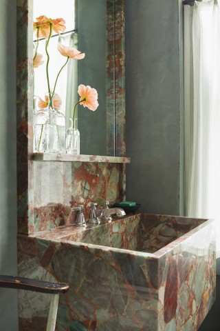 Pinstripe Widespread Faucet    The strongly masculine contours of the sink and mirror are softened by the soft greens and pinks, with the bright chrome faucet serving as a reference point and middle ground.