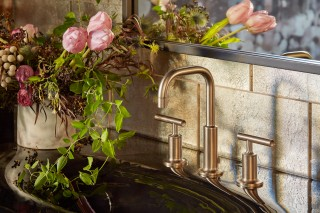 Purist faucet    Iron/Impressions vanity-top sink    ANN SACKS Versailles field tile    The stately, refined presence of the faucet combines with the dark cast iron sink and field tile to create a scene equal parts South Florida luxe and 17th-century Renaissance.
