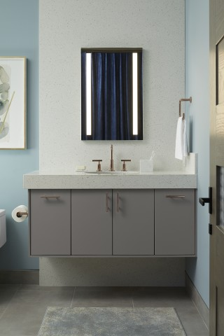 Jute® wall-hung vanity    Purist® bathroom sink faucet    Verdera® medicine cabinet    With built-in dimmable lighting, the medicine cabinet unclutters the wall area and offers convenient storage options.