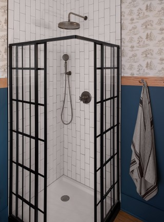 Traditional round rainhead    Artifacts handshower    Artifacts valve trim    Vertically oriented subway tile adds the impression of height and complements the orientation of the shower door panels.