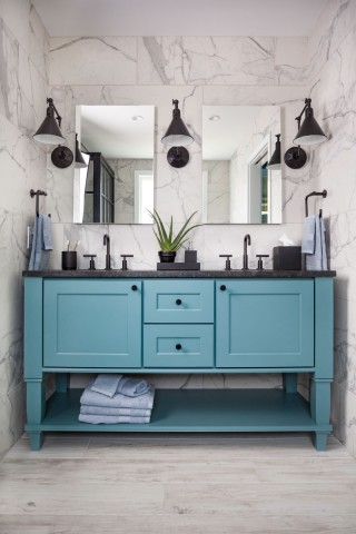 Purist faucet    Caxton Oval sink    Verdera Mirror    Purist towel ring    A mix of whites, grays and blacks calls forward the deceptively complex French blue used for the vanity. A blend of industrial and traditional design cues gives the master bath visual dynamism and intrigue.