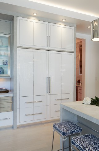 Fine details like these patterened barstools and recessed lighting make the kitchen shine.