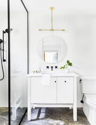 Tresham® vanity    Corbelle® toilet    Purist® bathroom sink faucet    With white taking the lead role here, each contrasting color takes on added significance in this boldly minimalist guest bathroom.