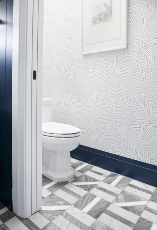 Kathryn toilet    ANN SACKS Liaison by Kelly Wearstler mosaic tile    A whimsical, geometric wallpaper connects with the flooring and the clean, angular lines of the toilet.