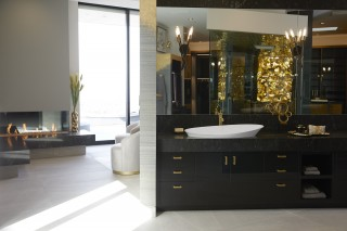 Veil™ trough vessel bathroom sink    Purist® bathroom sink faucet    As modern life grows ever more complex and stressful, it's no surprise that our home designs have sought balance through aesthetic simplicity and relaxing indulgence. A sitting area and fireplace offer the perfect place to escape.