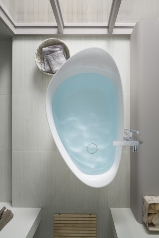 Veil Freestanding Bath     Composed Floor Mount Bath Filler    Allow white fixtures to pop with floors and wall treatments in the grey color family. Add natural light to make the bathroom feel airy and calm.