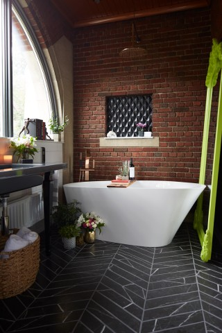 Loure® floor-mount bath filler    Veil™ freestanding bath    The Veil freestanding bath provides a deep, relaxing soak.