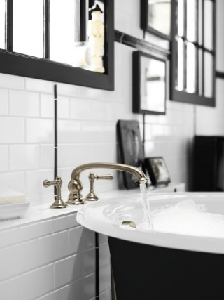 Artifacts® lever bath handles    Artifacts bath spout with arc design    Iron Works® Historic freestanding bath    The Vibrant® Brushed Bronze finish gives this bath faucet combination an inviting warmth.
