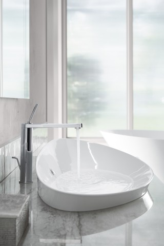 Veil Trough Vessel Sink     Composed Sink Faucet    Mixing contemporary trends like stonewashed marbles, curved fixture contours and elegant faucet finishes shows how modern design can be subtly eye-catching.