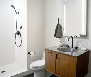 San Souci toilet    Verdera lighted medicine cabinet    Components faucet spout    Components faucet handles    Modern minimalism is on full display with sleek lines and the integration of innovative technologies.