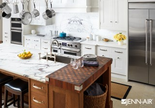 Custom cabinetry, a butcher-block wood countertop, and marble backsplash give this New York open kitchen an approachable elegance. At its heart is the new Wi-Fi-enabled Connected Wall Oven, with a...