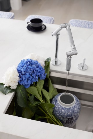 Karbon kitchen faucet    Prolific sink    The innovative flexibility of the Karbon kitchen faucet makes a splash in this modern space.
